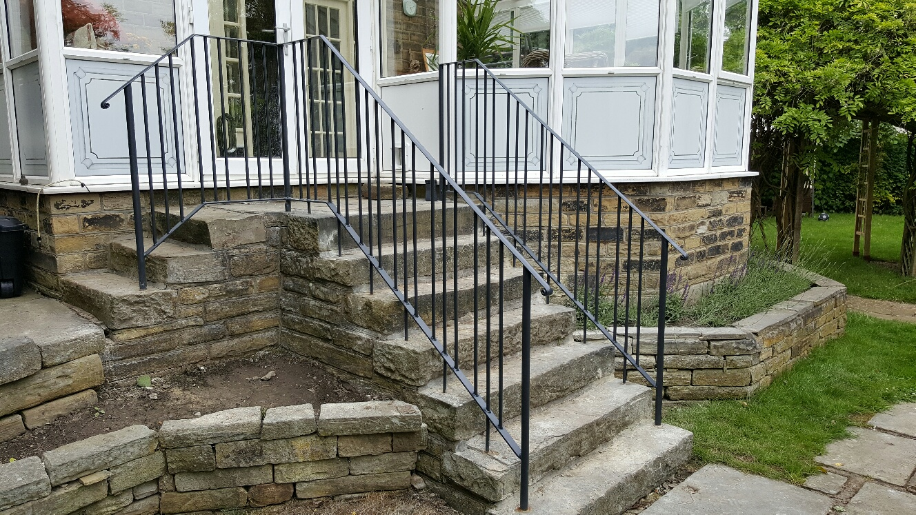 Wrought iron handrails in anthracite grey - resin fixed