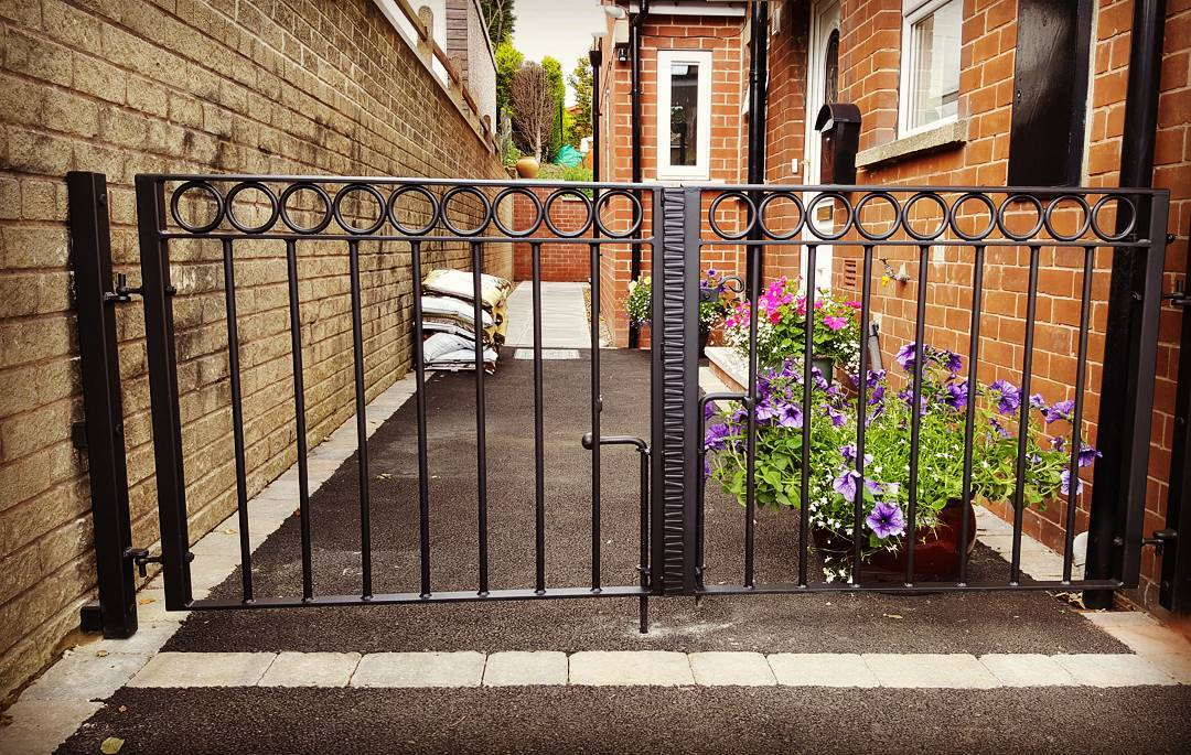 wrought iron driveway gates with rings detail